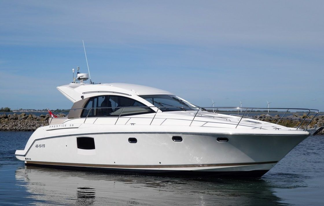 Jeanneau Prestige 38s powerboat heading out of the marina on delivery to Torquay.