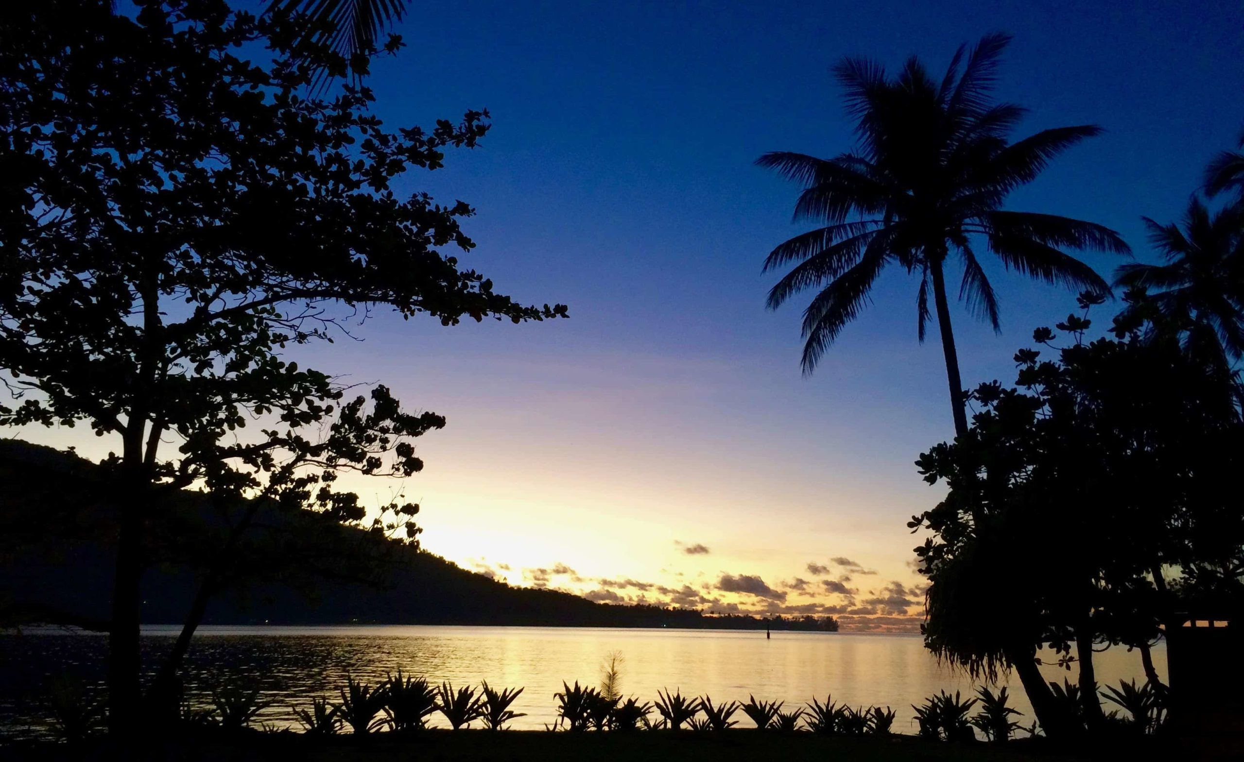Sunset over the mountains in Moorea, French Polynesia