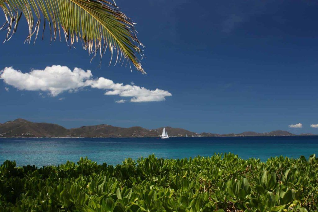 A lone sailing yacht on the blue seas of the BVI's - Caribbean.