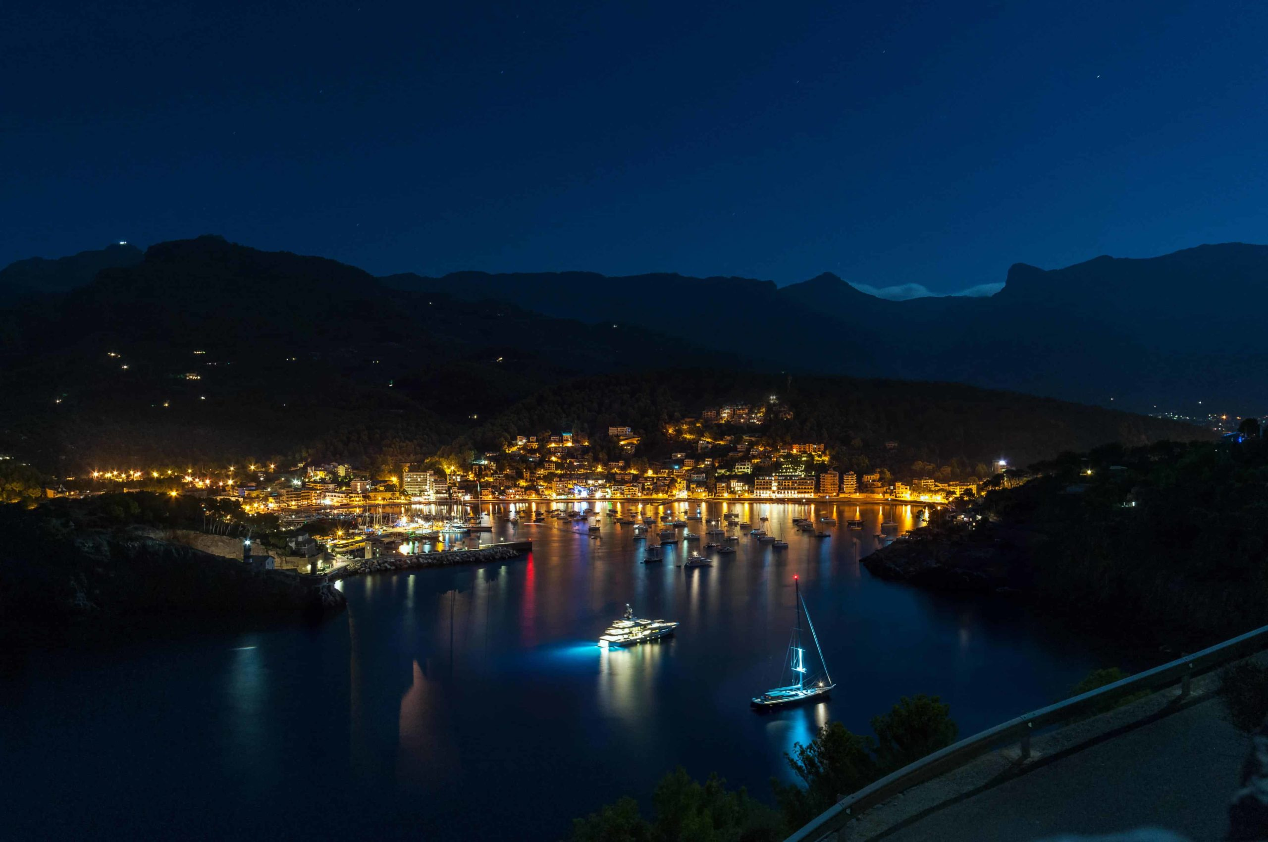 Night photo of lively harbour
