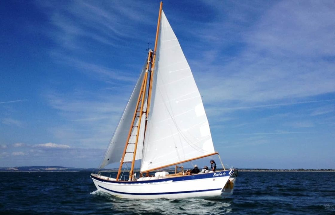 A classic yacht sailing on delivery