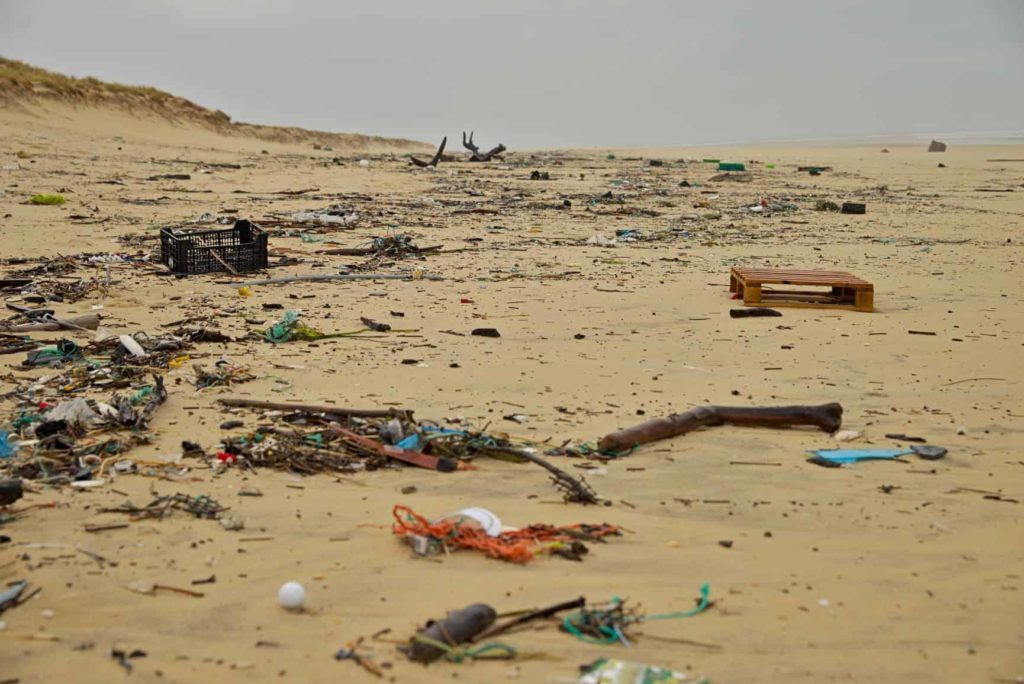 a beach covered in plastic rubbish