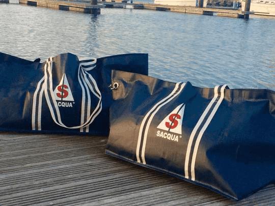 Two saqua sailing bags on the dock