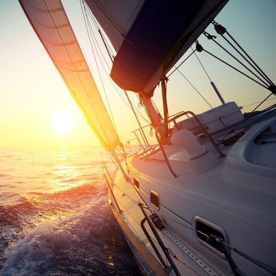 yacht sailing on delivery into the sunset