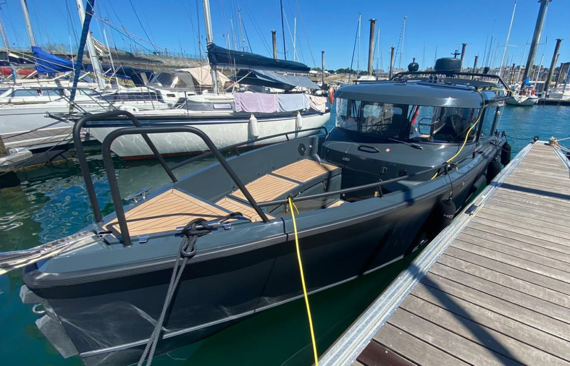 A fast XO270 motorboat moored up after delivery to St Malo.