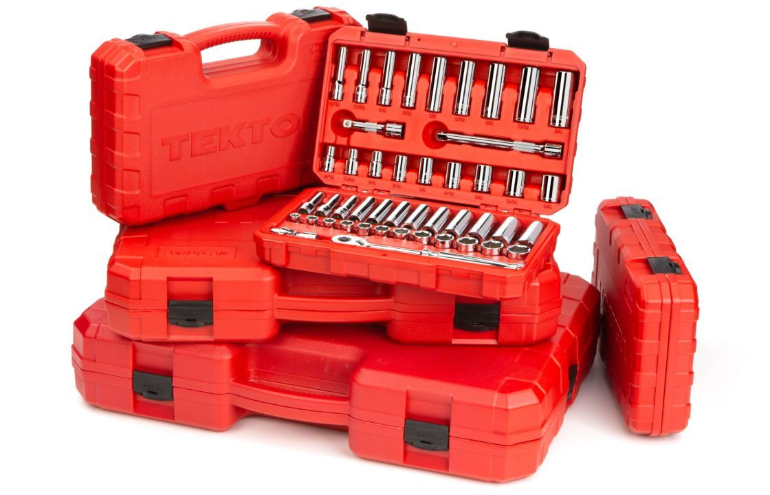 Red boxes of tools stacked together.