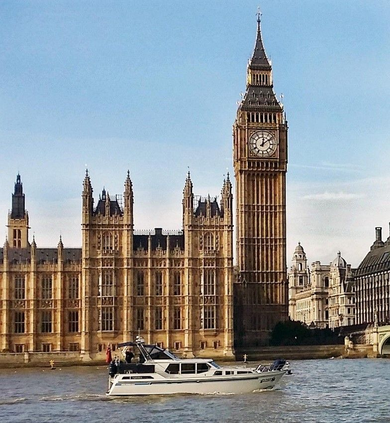 Polaris 1300 GL powerboat cruising down the Thames in from of Big Ben.